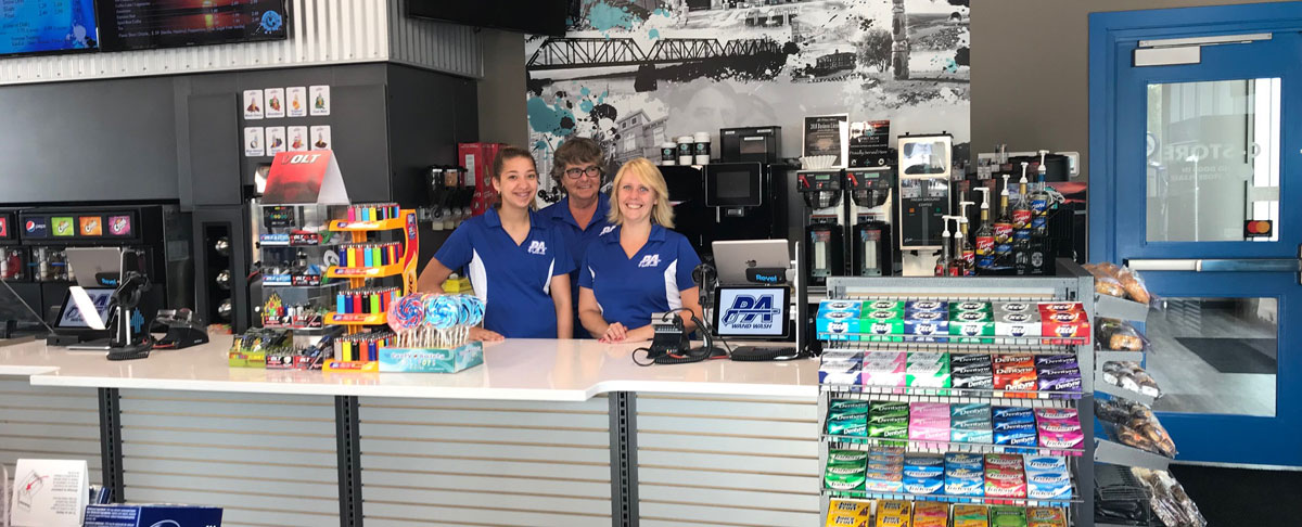 3 Women Behind A Counter Convenience Store